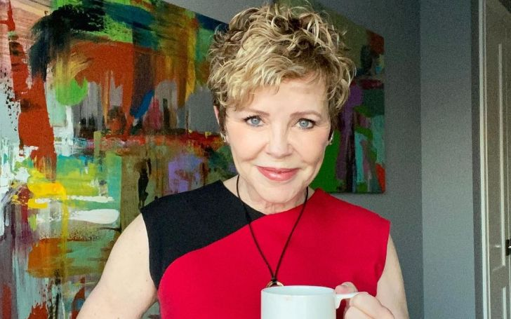 Patti Love Reid is drinking coffee.