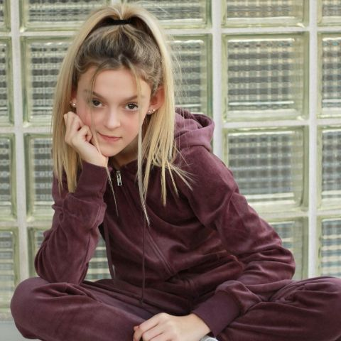 """Sarah Dorothy Little's first post, titled """"Mini Gabi Demartino,"""" featured her impersonating well-known beauty and fashion vlogger Gabriella Demartino."""