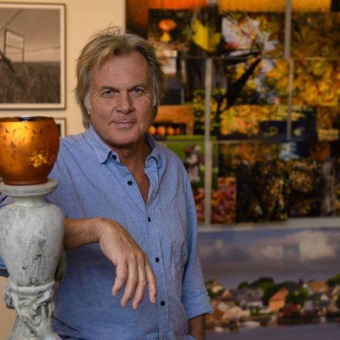 Jay Schadler in his art gallery room.