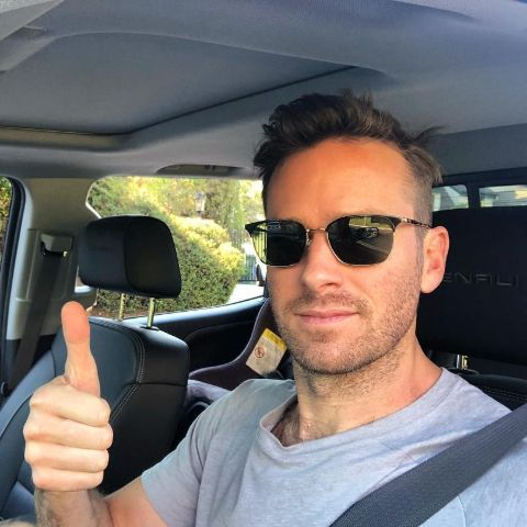 Armie Hammer is clicking selfie in his car.