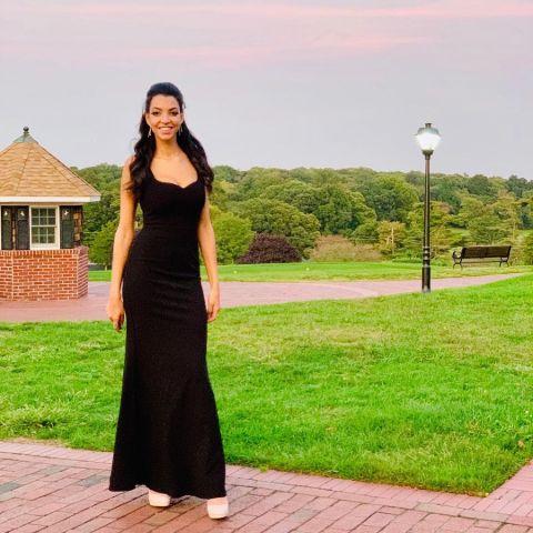 Randa Ali is wearing black dress.
