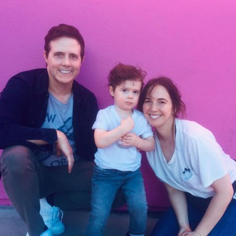 Danielle Morrow and Jeremy Rowley playing with their son.