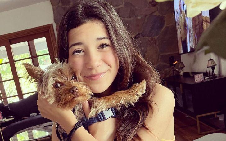 Scarlett Estevez is holding a dog.