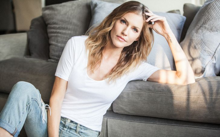 Tricia Janine Helfer is a former model and actress from Canada.