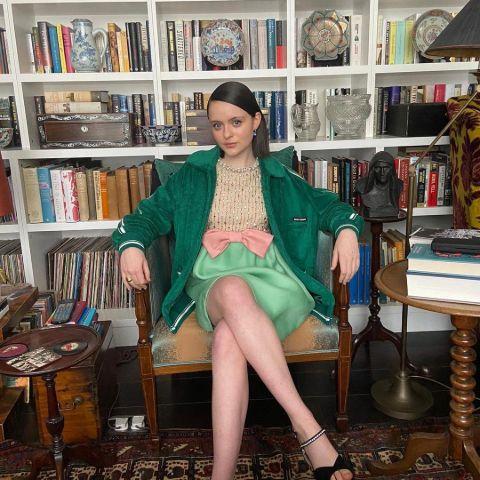 Viola Prettejohn is in a library.