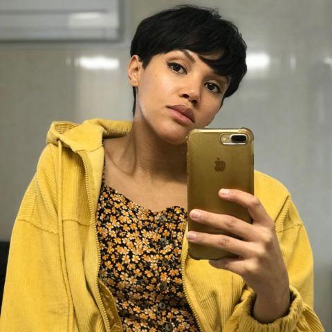 Lily Frazer is taking a mirror selfie.