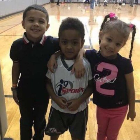 Zayden Banks is playing with his siblings.