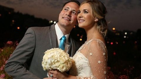 Gavy Friedson and Katie Pavlich posing for a picture on their wedding.
