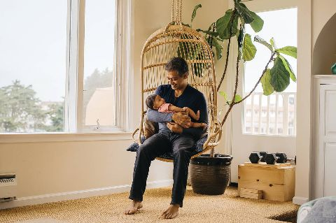 Naval Ravikant and his infant son, Neo, at their home in San Francisco.