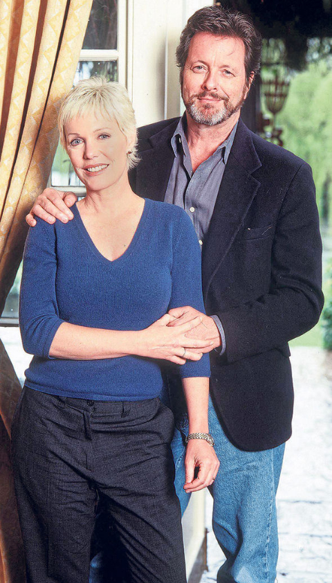 Ian Ogilvy posing with his wife.