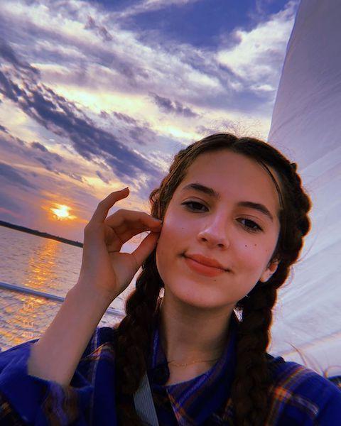 Eliza Pryor's selfie with sunset background.