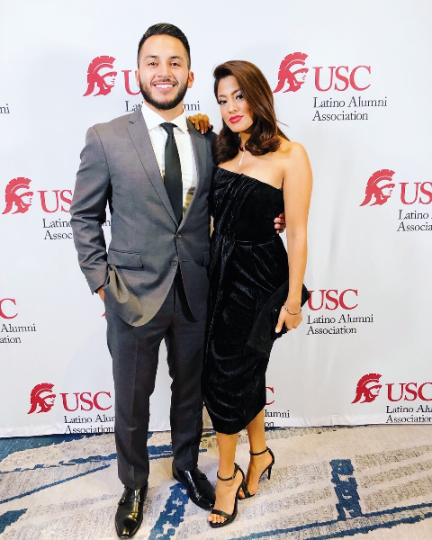Megan Telles and her husband posind for a picture.