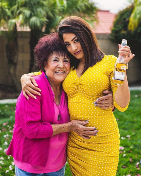 Megan Telles posing for a photo with her mother.