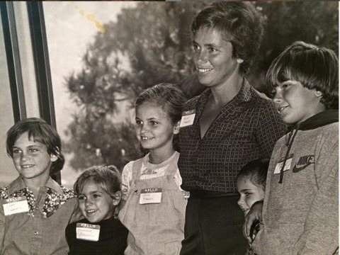 Arlyn Phoenix posing for a picture with her kids.