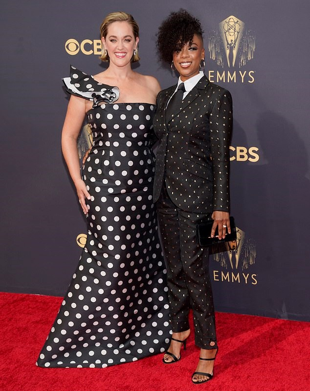 Samira Wiley wore a tailored black pantsuit with tiny three-dimensional silver lettering detail all over.