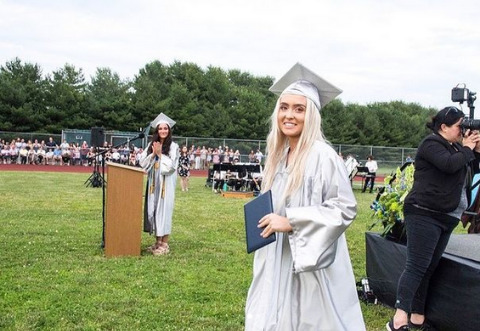 Annabelle posing for a picture at her graduation.