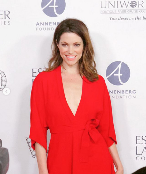 Courtney Henggeler posing for pictures at an event.