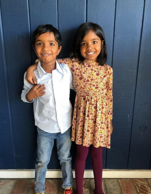 Vali's kids posing together for a picture.